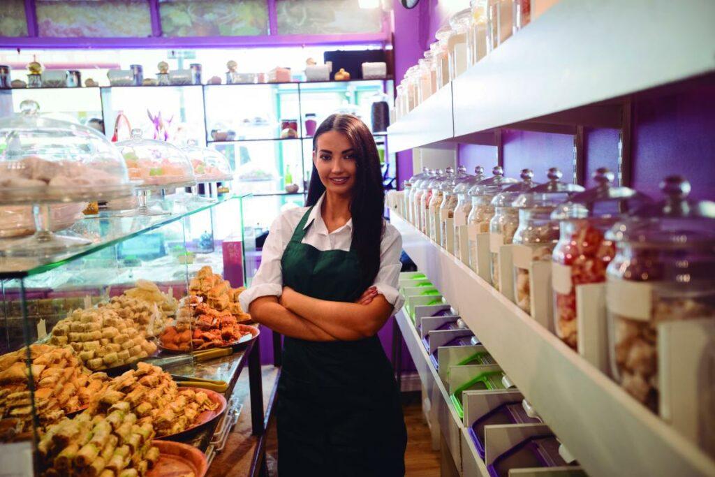 mini 2portrait of female shopkeeper standing at turkish sweets counter 1024x683 - Comercio de proximidad
